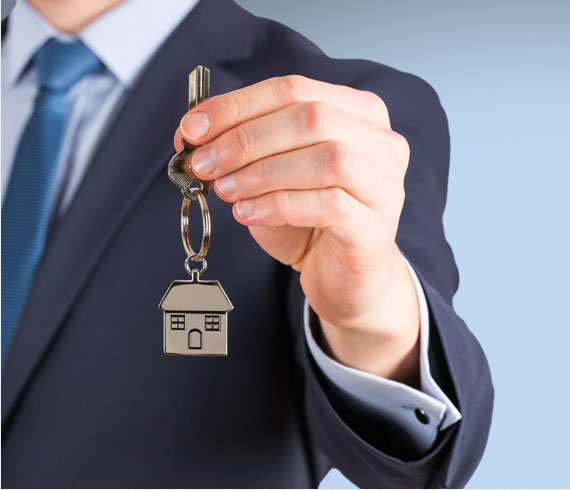 Picture of a banker handing a set of keys to a new homeowner
